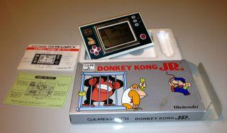 DONKEY KONG JR DJ 101 – 1982 NINTENDO GAME & WATCH – GAME + MANUAL
