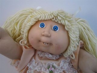 Vintage 1980s Cabbage Patch Kids blonde doll in original outfit with