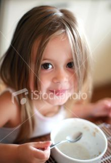 Little girl eating breakfast Royalty Free Stock Photo
