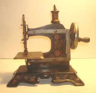 ANTIQUE CHILDS SEWING MACHINE , TIN LITHO, HAND CRANKED, BEAUTIFUL