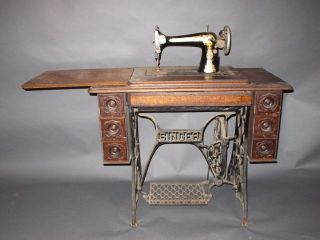 antique 1913 singer sewing treadle machine w cabinet egyptian revival