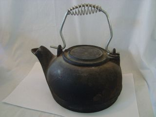 antique cast iron kettle with swivel lid