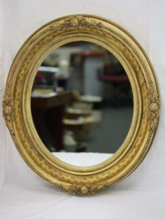 your consideration is this antique oval gold gilt gesso wall mirror