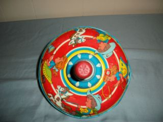 Vintage OHIO ARTS Metal Toy Spinning Top, beautiful colors cowboys