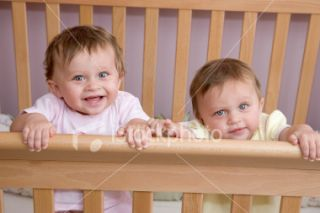 People   10 Month Old Twin Baby Girls in Crib Royalty Free Stock Photo