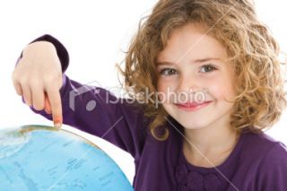 Cute little girl pointing at globe Royalty Free Stock Photo