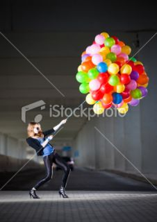 stock photo 12742428 woman holding many balloons