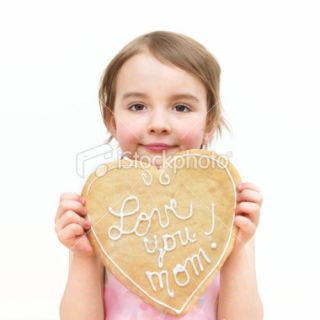 stock photo 9046998 little girl holding a cookie
