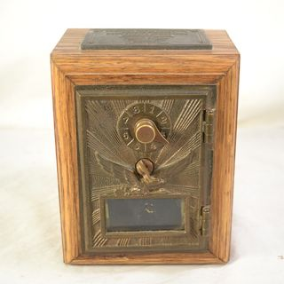 this is a previously owned vintage post office lock box bank safe the