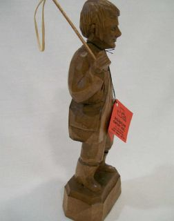 Old stock. Quebec carver signed Caron   Young man with fishing rod.