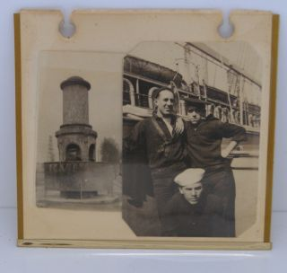 frame shows three sailorand a public street side urinal in france