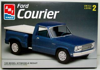 this auction includes an amt ertl ford courier pickup truck 1 25 scale