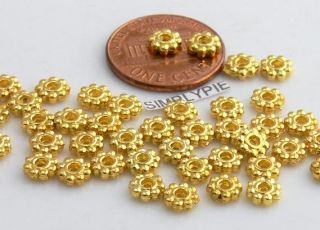 Beautiful gold plated metal daisy spacer beads. Please check our