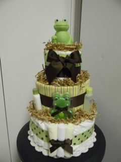 tier diaper cake loaded with lots of baby items and placed in a cake