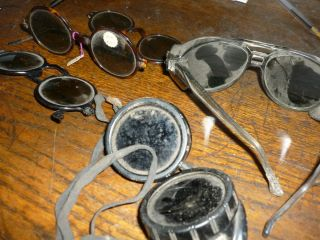 pair of old eye glasses     aviator ? three pair from old doctors desk