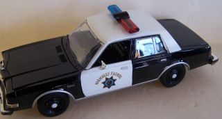 24 SCALE DIECAST 1986 DODGE DIPLOMAT CALIFORNIA HIGHWAY PATROL LOGOS