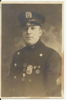Early 1900 New York Police Officer with Badge and Cap