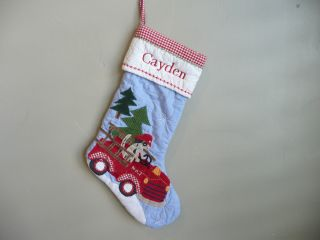 Pottery barn fire truck dog stocking will christmas for Stocking clips for fireplace