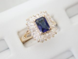 Emerald Cut Sapphire Cubic Zirconia Ring with Baguettes
