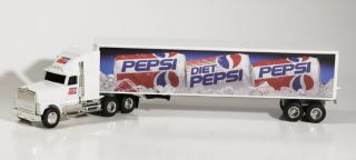 This Ertl Diecast Truck is a Pepsi International Tractor Trailor. It