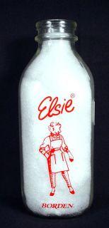 Borden's Elsie Cow in pants suit design on a quart milk bottle