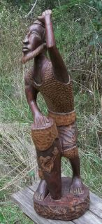 PRIMITIVE CARVED WOODEN AFRICAN DRUMMER SCULPTURE. LARGE, ENGAGING