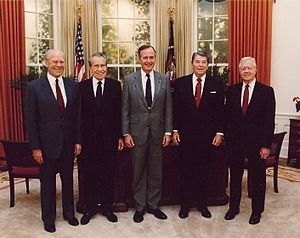 Jimmy Carter (far right) in 1991 with President George H. W. Bush