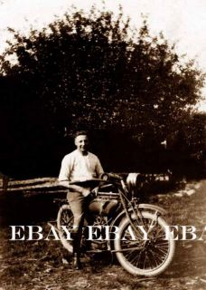 The Old Motorcycle Rider on His Vintage Bike Photo