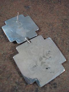 silver santa fe cross earrings are marked harold j harold joe navajo