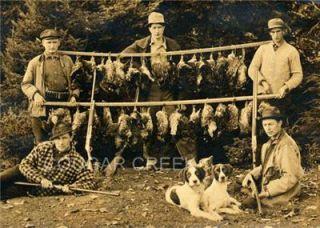 Five Grouse Hunters And Two Bird Dogs With A Bunch Of Grouse On Two