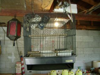 VINTAGE HOEI BLACK PLASTIC AND WIRE HANGING BIRD CAGE OR CARRIER