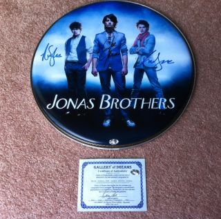 Jonas Brothers Autographed Drumhead with Certificate of Authenticity