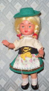 VINTAGE HARD PLASTIC DOLL SWITZERLAND LITTLE GIRL IN AUTHENTIC GREEN