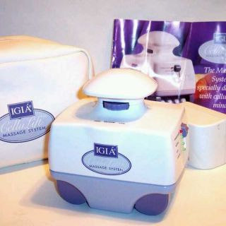 IGIA CELLULITE TREATMENT MACHINE SUCTIONS MASSAGES HEATS STIMULATES