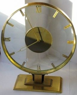 Angelus 8 days clock in brass & scaloped crystal 8 1/2 in.