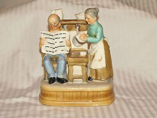 Vintage Porcelain Figurine of an Old Couple with music box