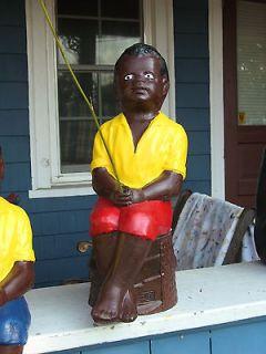 BLACK FISHING BOY STATUEW. CONCRETE STUMP.& BAMBOO POLE. (LAWN