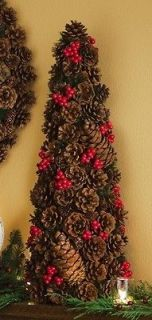 artificial christmas tree with pine cones